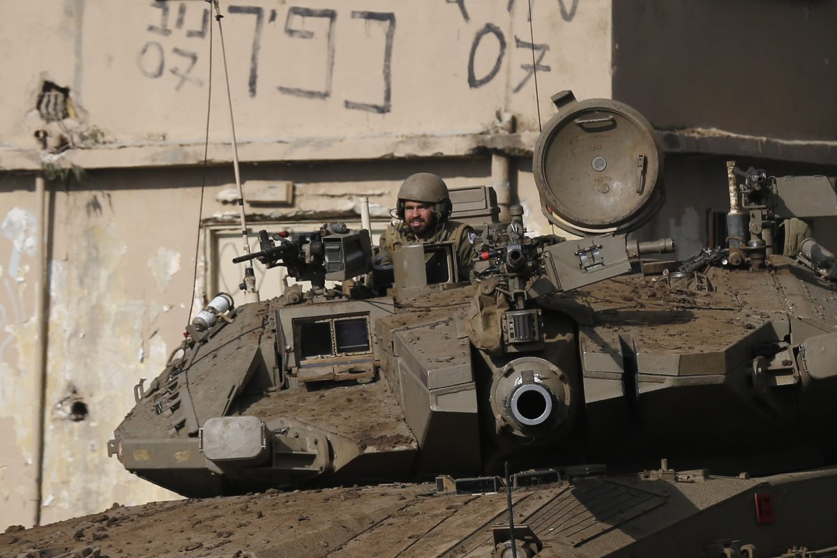 An Israeli soldier sits in an army Merkava tank during a military drill in the Israeli-annexed Golan Heights on 12 February 2019 [JALAA MAREY/AFP/Getty Images]
