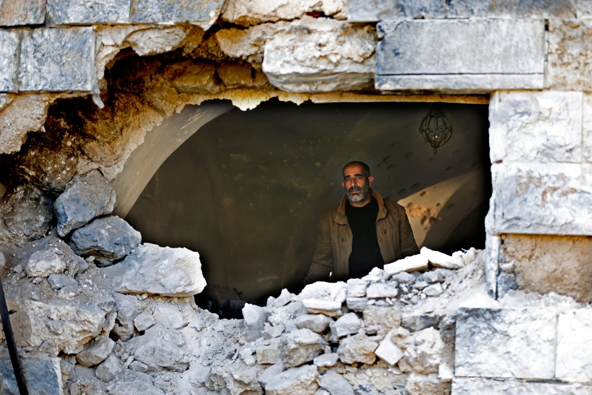 A Palestinian man stands inside a building which was raided by Israeli troops in Ramallah, on 20 March 2019 [ABBAS MOMANI / AFP/Getty]