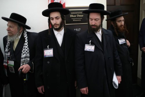 Orthodox Jews with the group Jews United Against Zionism gather outside the office of Rep. Ilhan Omar (D-MM) in a show of support on 06 March 2019 in Washington, DC. [Win McNamee/Getty Images]