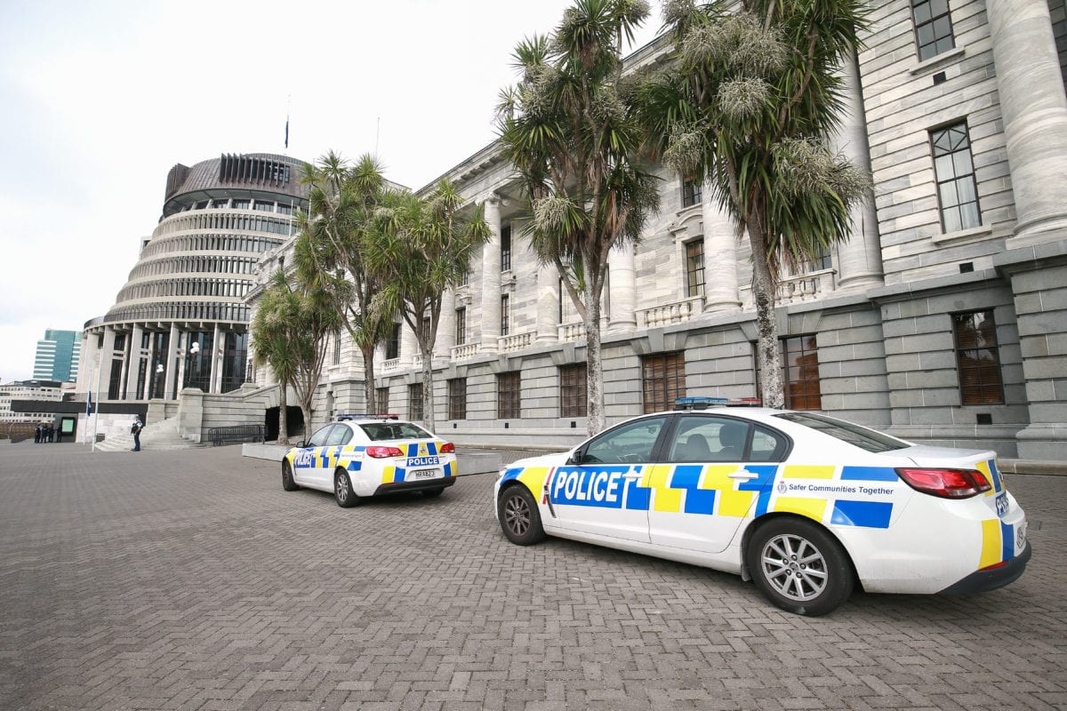 Police cars parked outside Parliament on March 18, 2019 in Wellington, New Zealand. Prime Minister Jacinda Ardern said 'our gun laws will change' in a press conference following attacks on two Christchurch mosques that killed 50 people on Friday, March 15. [Hagen Hopkins/Getty Images]