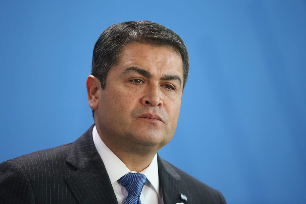 Honduran President Juan Orlando Hernandez speaks to the media with German Chancellor Angela Merkel (not pictured) following talks at the Chancellery on 27 October 2015 in Berlin, Germany. [Sean Gallup/Getty Images]