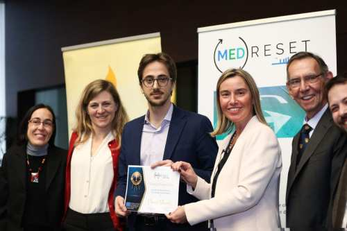 Omar Shanti [centre], winner of the European Union (EU)'s Young Writers Prize, receives a ceritificate from Federica Mogherini, the EU's High Representative for Foreign Affairs and Security Policy and Vice-President of the European Council in Brussels, on March 6, 2019 [European Commission]