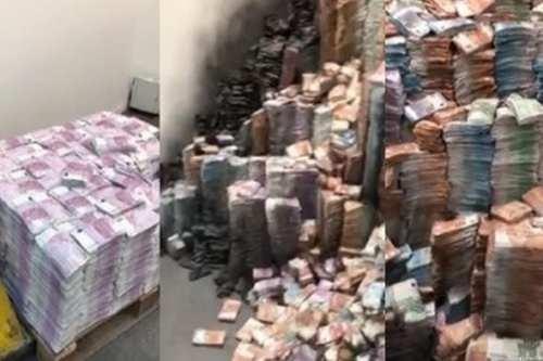 Sudanese bank notes can be seen piled up in preparation for burning [Social media]
