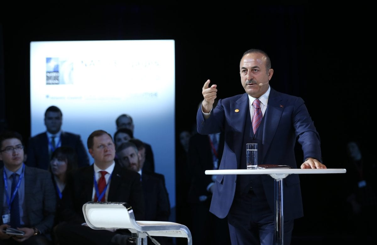 """Turkish Foreign Affairs Minister Mevlut Cavusoglu makes a speech as he attends the panel named as """"Turkey's Role in NATO and Regional Security"""" that held by Atlantic Council, German Marshall Fund and Munich Security Conference in Washington, United States on 3 April 2019. [Fatih Aktaş - Anadolu Agency]"""