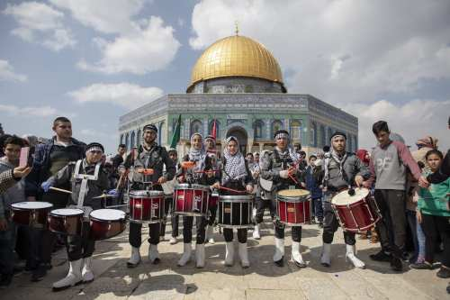 A band performs during an event to mark the Lailat al-Isra and Miraj at Jerusalem's iconic Al-Aqsa Mosque on 3 April 2019. [Faiz Abu Rmeleh - Anadolu Agency]