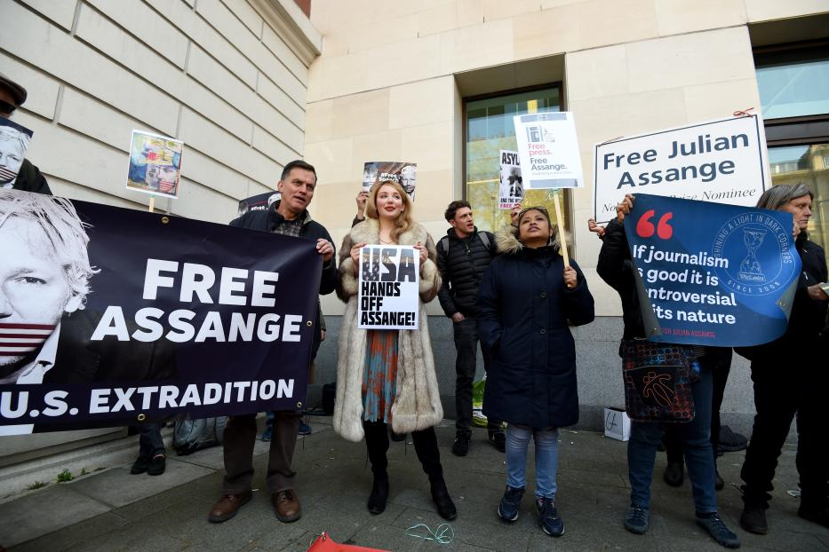 People stage a protest outside Westminster Magistrates court after WikiLeaks founder Julian Assange was arrested in Ecuador's Embassy in London, United Kingdom on April 11, 2019. [Kate Green - Anadolu Agency]