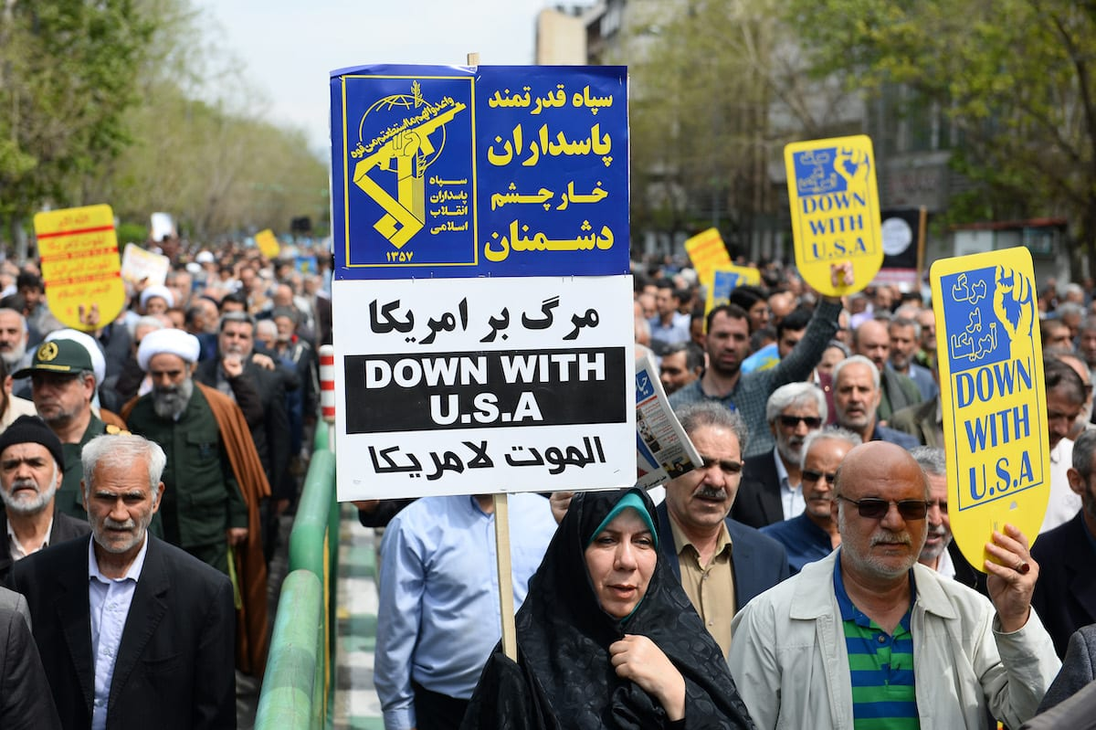 """Iranians hold anti-US placards as they take part in a protest against the Trump administration's designation of Iran's Islamic Revolutionary Guards Corps (IRGC) as a """"terrorist organization"""" in Tehran, Iran on 12 April 2019. [Fatemeh Bahrami - Anadolu Agency]"""
