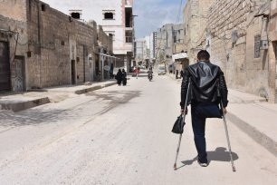 Syrian Rabeh Selim walks in the streets of the northern Syrian city of Al-Bab. Despite losing his leg in the ongoing conflict in Syria, a father of five continues to hold on to life to provide for his family. on 9 April 2019 ( Meryem Göktaş - Anadolu Agency )