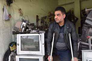 Syrian Rabeh Selim is seen at his shop in the northern Syrian city of Al-Bab. Despite losing his leg in the ongoing conflict in Syria, a father of five continues to hold on to life to provide for his family. on 9 April 2019( Meryem Göktaş - Anadolu Agency )