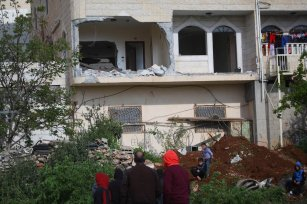 Palestinians inspect the house of Palestinian Arafat Irfaiyye, after it was demolished by a Israeli army in Hebron, West Bank on April 19, 2019. ( Mamoun Wazwaz - Anadolu Agency )