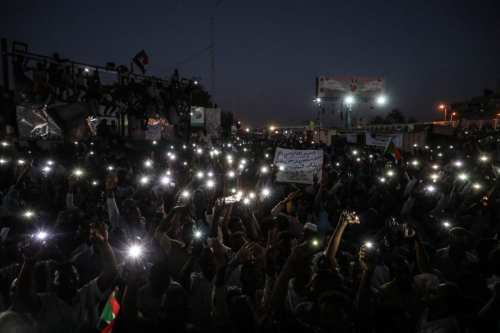 Sudanese demonstrators gather in front of military headquarters during a demonstration after The Sudanese Professionals Association's (SPA) call, demanding a civilian transition government, in Khartoum, Sudan on April 21, 2019. ( Mahmoud Hjaj - Anadolu Agency )