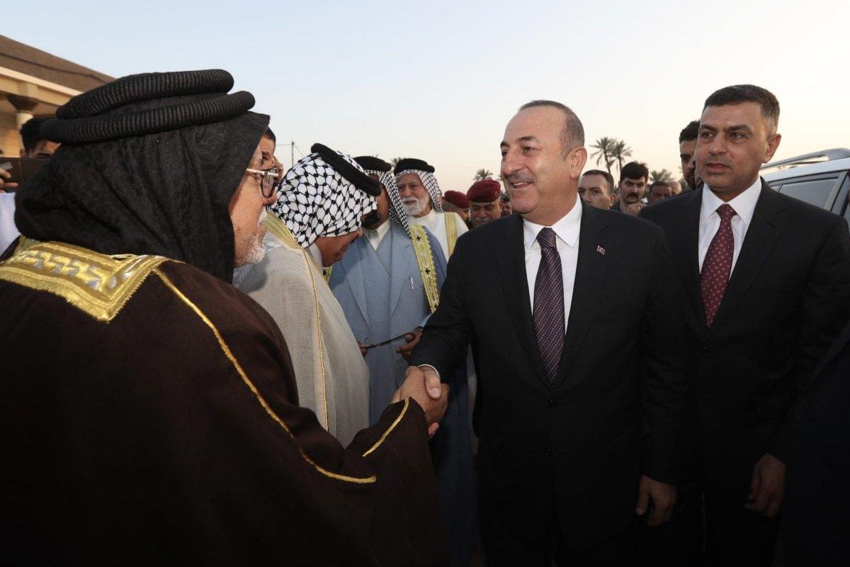 Turkish Foreign Affairs Minister Mevlut Cavusoglu (2nd R) and Governor of Basra Province Asaad Al Eidani (R) arrive to visit al Eidani Council in Basra, Iraq on April 28, 2019. [Cem Özdel - Anadolu Agency]