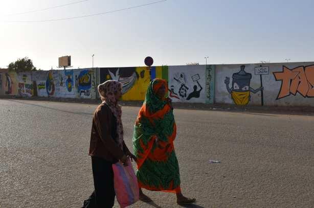 "Graffitis are seen on a wall after ""removal"" of President Omar al-Bashir, who had ruled Sudan since 1989, in Khartoum, Sudan on 29 April, 2019 [Ömer Erdem/Anadolu Agency]"