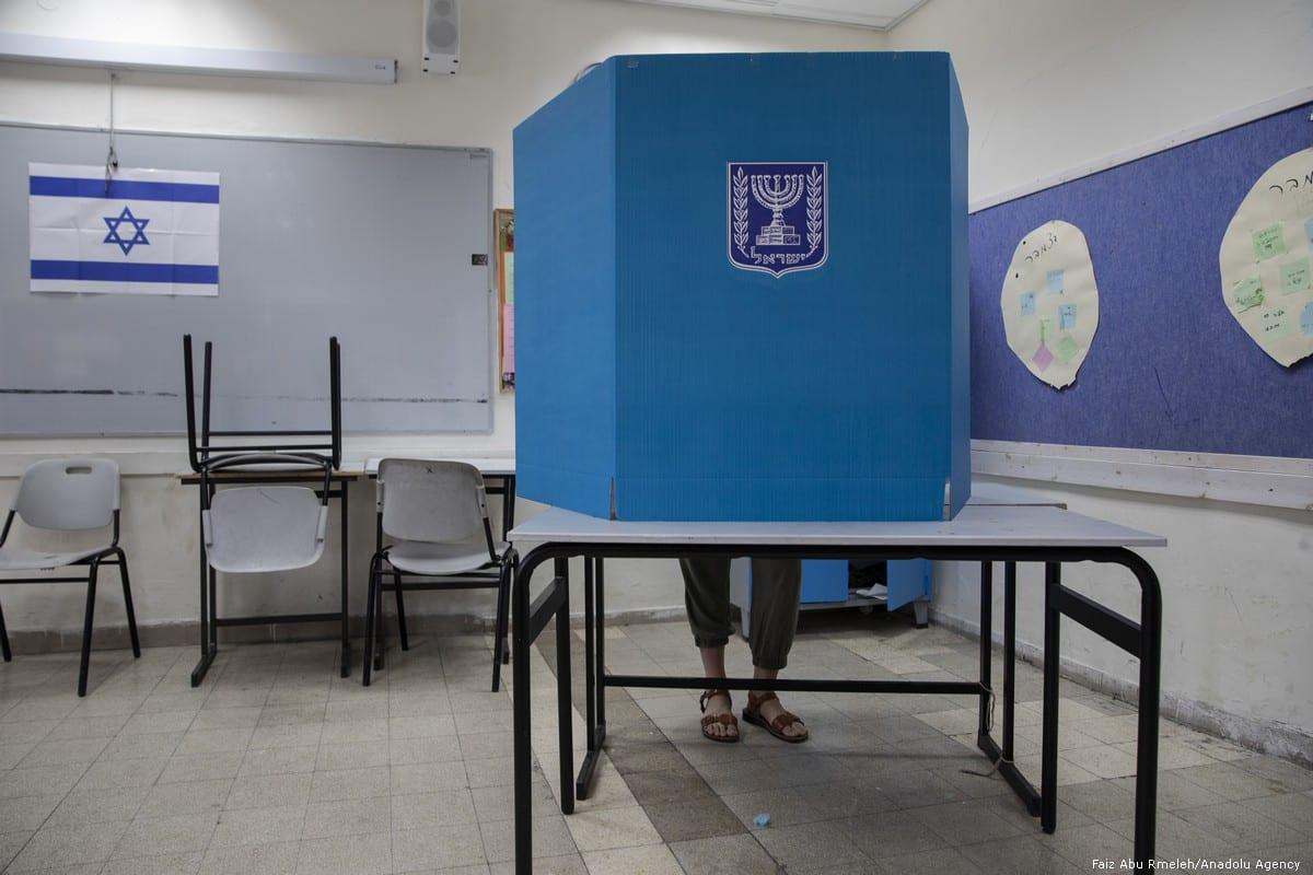 A man casts his vote during the Israeli general elections in Tel Aviv on 9 April 2019 [Faiz Abu Rmeleh/Anadolu Agency]