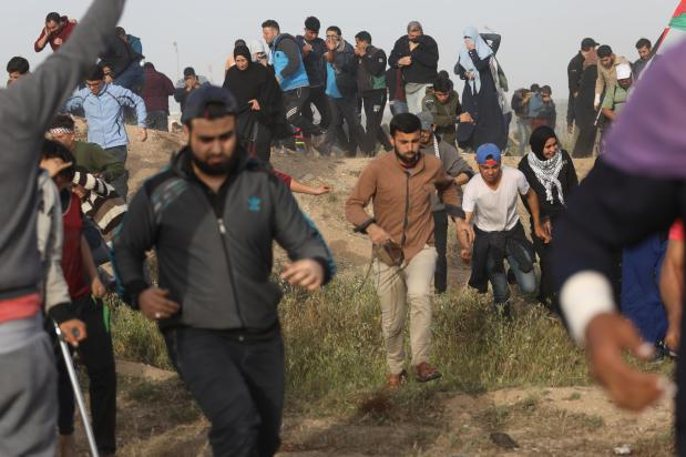 Palestinians protesting in Gaza injured by Israeli forces, April 2019 [Mohammed Asad/Middle East Monitor]