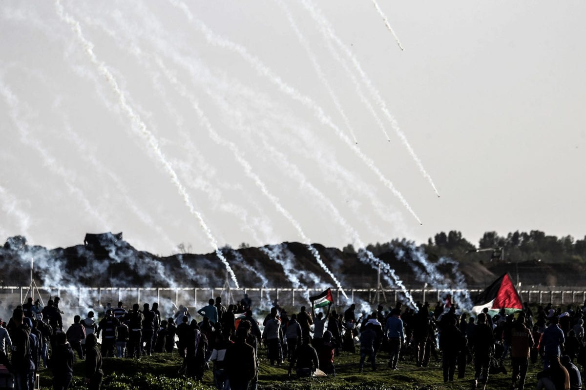 Israeli forces fire tear gas at Palestinians during the Great March of Return on 9 February 2019 [MAHMUD HAMS/AFP / Getty]