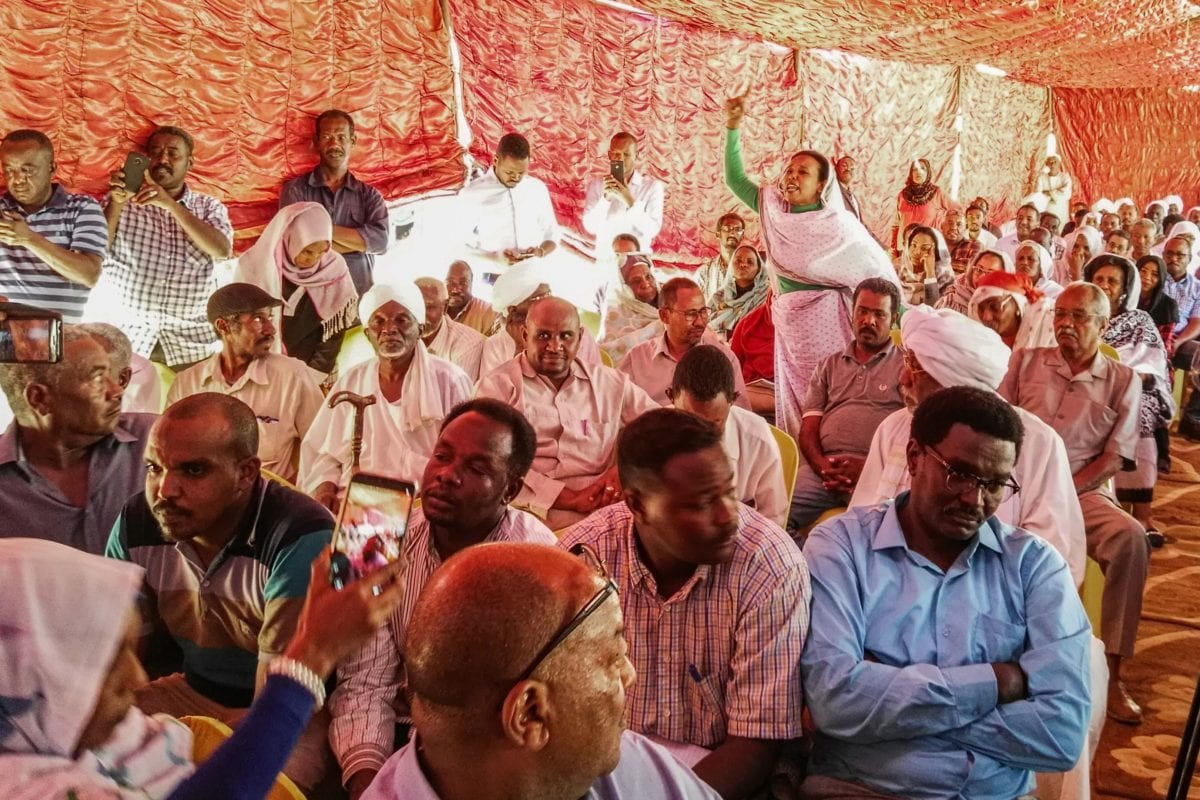 Supporters of Sudan's main opposition Umma Party attend a press conference by representatives of the party in the capital Khartoum's twin city of Omdurman on February 13, 2019. [AFP / Getty]