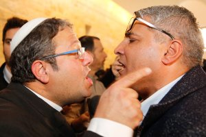 Jewish Power party's Itamar Ben Gvir (L) argues with the Israeli Arab candidate Ata Abu Medeghem of Raam-Balad after a hearing at the Israeli Supreme Court in Jerusalem, on March 14, 2019. [GIL COHEN-MAGEN / AFP / Getty]