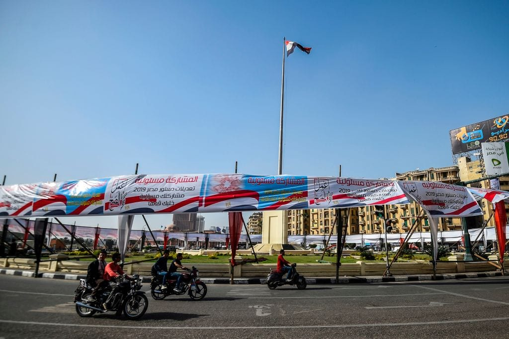 """Banners reading in Arabic """"do what is right"""", """"participation is a responsibility"""", to urge Egyptians to participate in an upcoming referendum for the constitutional amendments, hang in Tahrir Square in Cairo on 8 April 2019. [MOHAMED EL-SHAHED/AFP/Getty Images]"""