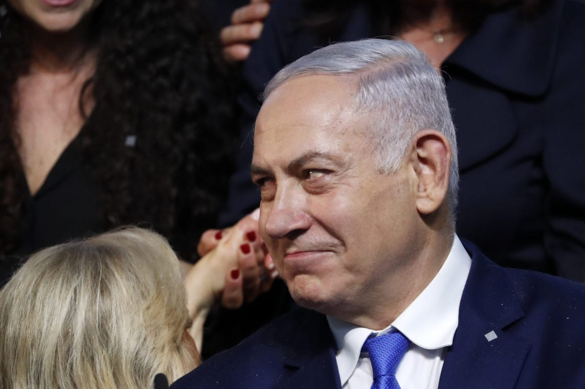 Israeli Prime Minister Benjamin Netanyahu reacts after addressing supporters at his Likud Party headquarters in the Israeli coastal city of Tel Aviv on election night early on 10 April 2019 [Thomas COEX/AFP/Getty]