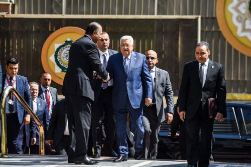Palestinian president Mahmoud Abbas (C) is greeted upon his arrival at the Arab League headquarters in the Egyptian capital Cairo, to discuss the latest developments in the Palestinian territories on April 21, 2019. [MOHAMED EL-SHAHED / AFP / Getty]