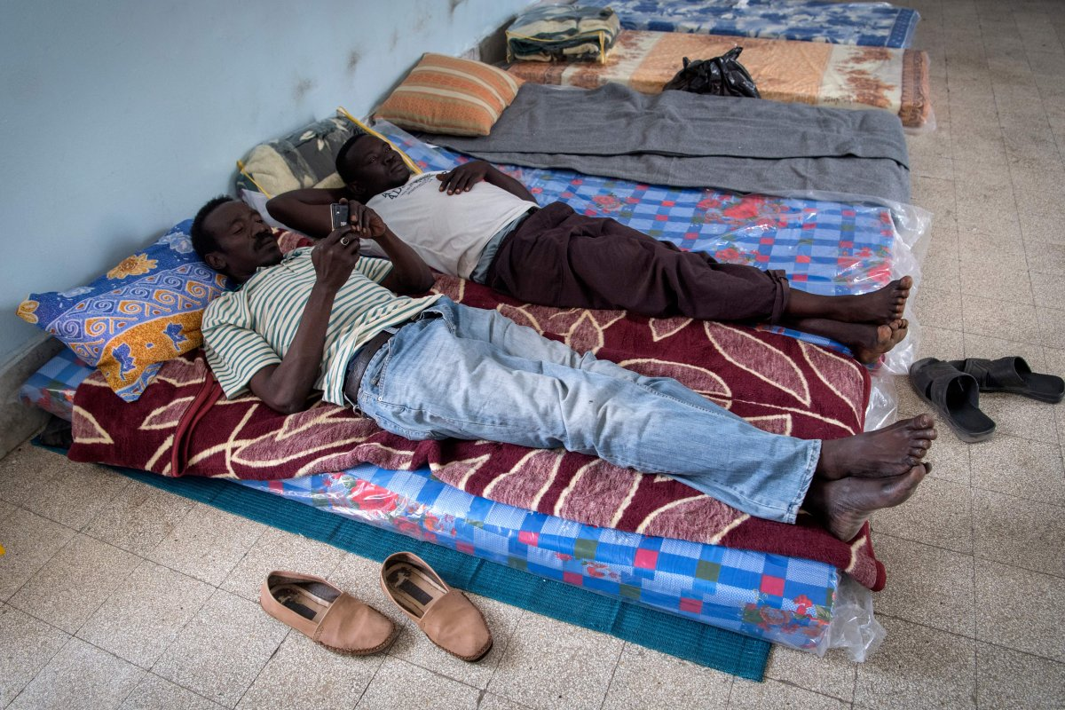 Sudanese refugees, who fled from violence between forces loyal to the internationally recognised Government of National Accord (GNA) and forces loyal to Khalifa Haftar, rest at a school in Libya's capital Tripoli on 24 April 2019 [FADEL SENNA/AFP/Getty]
