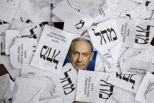 Copies of ballots papers and campaign posters for Israel's Prime Minister Benjamin Netanyahu's Likud Party lie on the ground in the aftermath of the country's parliamentary elections, early on 18 March, 2015 in Tel Aviv [AFP PHOTO/JACK GUEZ/Getty]