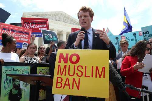 US Sen. Joe Kennedy III (D-MA) speaks about US President Trump's travel ban outside the US Supreme Court following a court issued immigration ruling on 26 June 2018 in Washington, DC. [Mark Wilson/Getty Images]