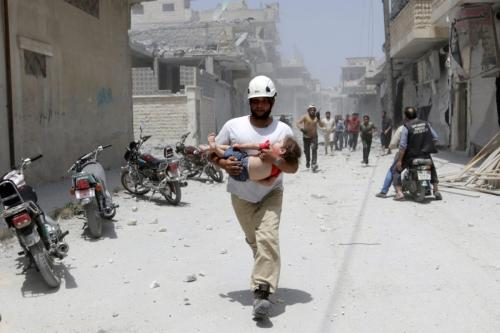 A civil defence member carries an injured girl following air strikes which hit Idlib, Syria 2 June 2016 [REUTERS/Khalil Ashawi]