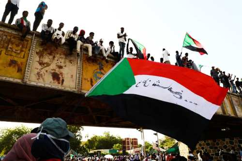 Sudanese demonstrators gather after the call of The Declaration of Freedom and Change (DFC), an alliance of opposition groups, in front of military headquarters, during ongoing demonstrations demanding a civilian transition government in Khartoum, Sudan on May 02, 2019. [Mahmoud Hjaj - Anadolu Agency]