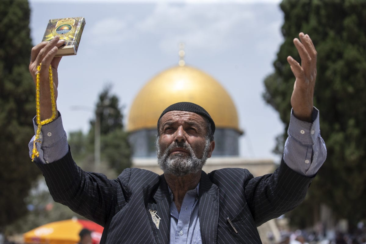 A Palestinian man is praying in front of the Kubbet'us-Sahra (Dome of the Rock) as the Muslims gather to perform the third Friday Prayer of Muslims' holy fasting month of Ramadan at the Al-Aqsa Mosque, Jerusalem on May 24, 2019. [Faiz Abu Rmeleh - Anadolu Agency]