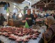 Tunisians go shopping during the holy month of Ramadan in Tunis, Tunisia on 6 May, 2019 [Yassine Gaidi/Anadolu Agency]