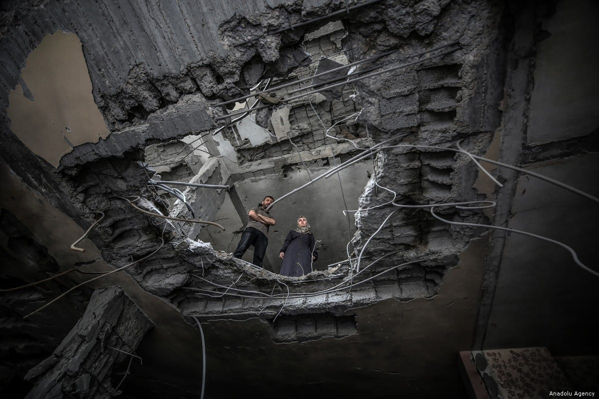 Centre staff and people with disabilities inspect the damaged building of Confederation of Disabled People, which was the only centre to serve people with disabilities in Rafah, after Israel's attacks on Gaza in Rafah, Gaza on 7 May, 2019 [Ali Jadallah/Anadolu Agency]