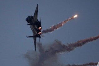 Israeli warplanes out air strikes across the besieged Gaza Strip, on predawn Thursday, allegedly in response to the launch of incendiary balloons by Palestinians [Maan News]