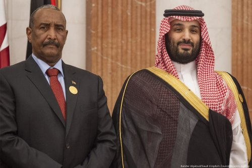 Crown Prince of Saudi Arabia Mohammad Bin Salman Al Saud (R) meets Head of the Sudanese Transitional Military Council (TMC), Abdul Fattah al-Burhan (L) during an emergency Arab League Summit at Al Safa Palace in Mecca, Saudi Arabia on May 31, 2019 [Bandar Algaloud / Saudi Kingdom Council / Handout - Anadolu Agency]