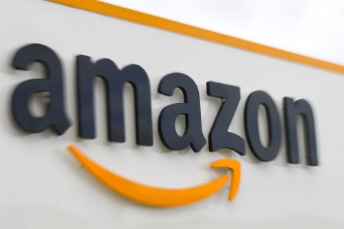 A picture shows the Amazon logo at the entrance area of the Amazon logistics centre in Lauwin-Planque, northern France, on 4 March, 2019 [DENIS CHARLET/AFP/Getty Images]
