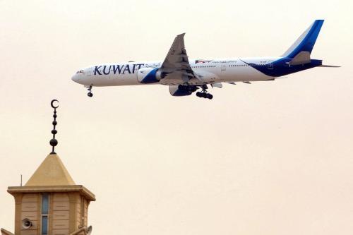 A Kuwait Airways Boeing B777 aircraft prepares to land at Kuwait International Airport in Kuwait City on 13 March 2019 [Yasser Al-Zayyat/AFP/ Getty]