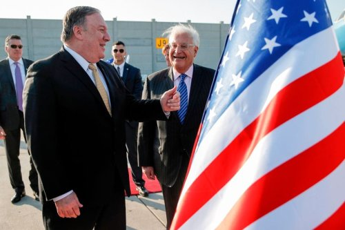 US Secretary of State Mike Pompeo (L) meets with US ambassador to Israel David Friedman (C) upon his arrival at Ben Gurion International Airport, near the Israeli city of Tel Aviv on 20 March, 2019 [JIM YOUNG/AFP/Getty Images]