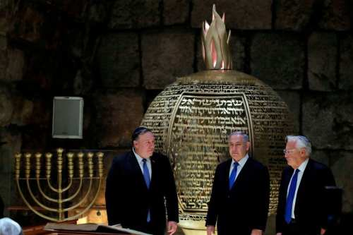 Israeli Prime Minister Benjamin Netanyahu (C), US Secretary of State Mike Pompeo (L) and US Ambassador to Israel David Friedman (R) visit the Western Wall Tunnels in Jerusalem's Old City on 21 March, 2019 [JIM YOUNG/AFP/Getty Images]