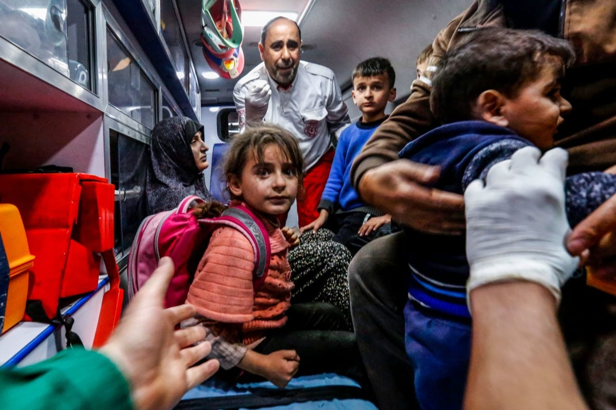 A Palestinian family waits for medical help inside an ambulance outside a hospital in Beit Lahia, northern Gaza strip on 5 May, 2019 [ANAS BABA/AFP/Getty]
