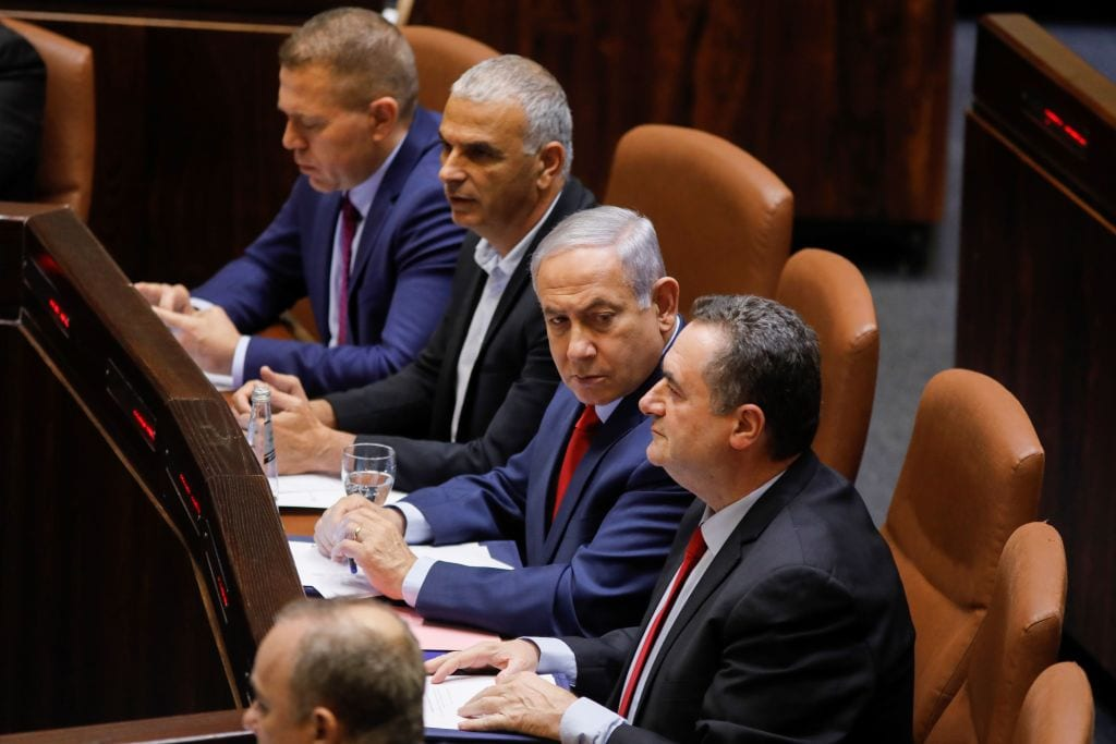 Israeli Prime Minister Benjamin Netanyahu (C) sits before a vote on a bill to dissolve the Knesset (Israeli parliament) on 29 May 2019, at the Knesset in Jerusalem. [MENAHEM KAHANA/AFP/Getty Images]