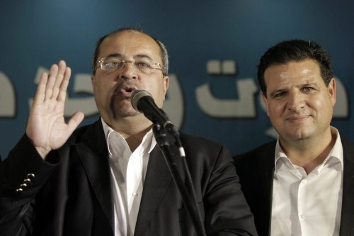 Hadash-Ta'al leader Ahmad Tibi (L) and Ayman Odeh on 17 March 2015 [AFP PHOTO AHMAD GHARABLI/Getty]