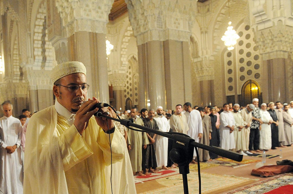 Imam Omar Kzabri adjusts his microphone at the Hassan II mosque before the Tarawih prayers performed during the Muslim holy month of Ramadan in Casablanca on 29 August, 2009. [ABDELHAK SENNA/AFP/Getty Images]