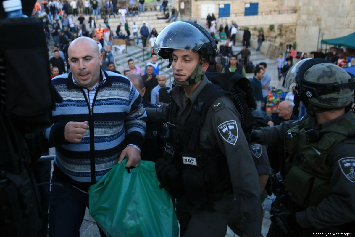 A Palestinian is arrested by Israeli security forces on 22 March 2014 at Jerusalem's Damascus Gate [Saeed Qaq/Apaimages]