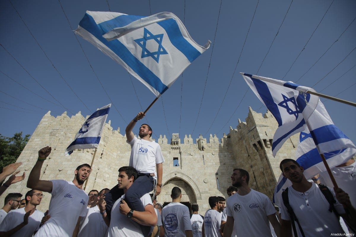 Jews participate in a celebration march as part of the 52nd anniversary of the occupation of East Jerusalem by Israel, at Jerusalem's Old City on June 02, 2019. Israel has illegally occupied East Jerusalem, where Al-Aqsa is located, since the 1967 Arab-Israeli War. [Faiz Abu Rmeleh - Anadolu Agency]