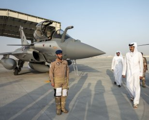 Emir of Qatar Sheikh Tamim bin Hamad al-Thani (C), Minister of State for Defense of Qatar Khalid bin Mohammad Al Attiyah (4th R) and Qatari Military Chief-of-Staff Ghanim bin Shahin al-Ghanim (2nd R) attend a ceremony for the delivery to Qatar of the first of Rafale jet fighters from French manufacturer Dassault Aviation, at Duhan Air Base in Doha, Qatar on 5 June, 2019 [DEFENCE MINISTRY OF QATAR/HANDOUT/Anadolu Agency]