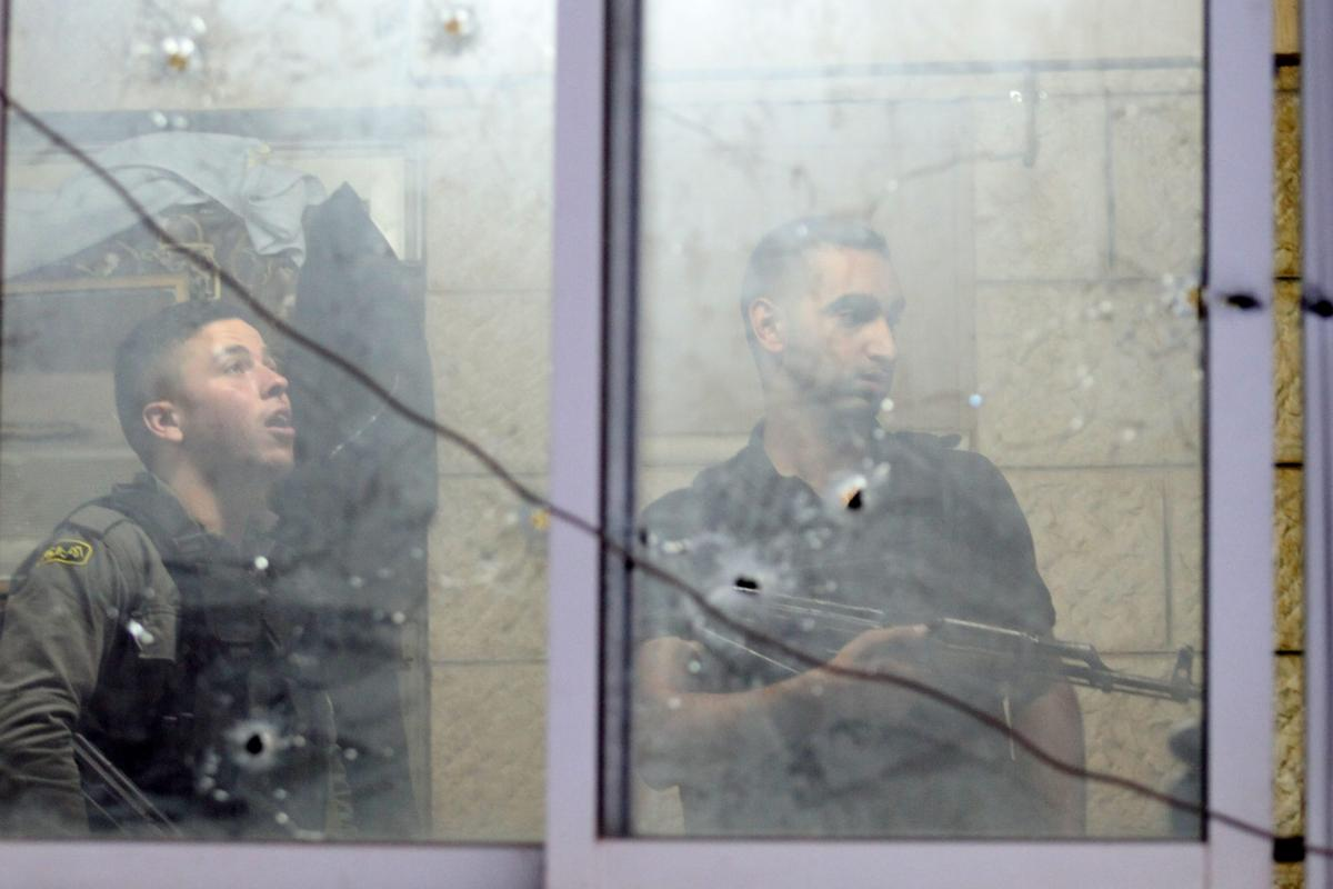 Bullet holes are seen on a window of the headquarters of the Palestinian Preventive Security, in Nablus, the West Bank, 11 June 2019 [Nedal Eshtayah/Anadolu Agency]