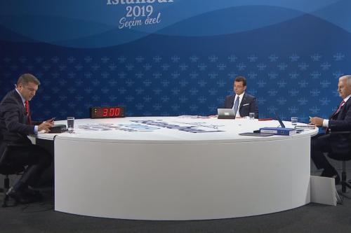 A screen grab captured from a video shows Istanbul mayoral candidate of ruling Justice and Development (AK) Party, Binali Yildirim (R) and Istanbul mayoral candidate of main opposition Republican People's Party (CHP), Ekrem Imamoglu (C) attending a live televised debate, on 16 June 2019 in Istanbul, Turkey. [AA/Anadolu Agency]