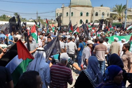 Palestinians protest against the ongoing US-led Bahrain workshop in Gaza on 26 June 2019 [Wafa Aludaini]