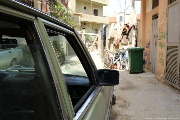 Driving through a narrow alley in Nahr Al-Bared camp.